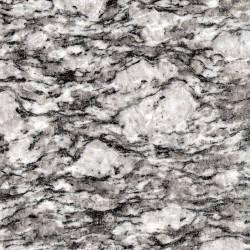 Kamen granit z belimi packami White Wave